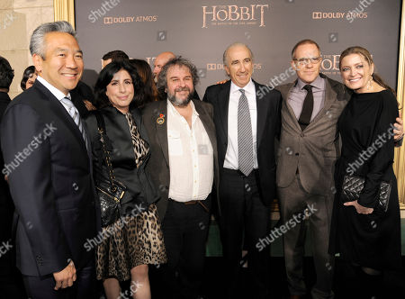 """Stock Photo of Kevin Tsujihara, chairman and CEO, Warner Bros, from left, Sue Kroll, president, worldwide marketing and international distribution for Warner Bros. Pictures, director Peter Jackson, Gary Barber, chairman and CEO of MGM, Toby Emmerich, president and COO, New Line Cinema and Carolynne Cunningham arrive at the Los Angeles premiere of """"The Hobbit: The Battle Of The Five Armies"""" at the Dolby Theatre on"""