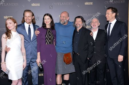 """Actors Lotte Verbeek, left, Sam Heughan, Caitriona Balfe, Graham McTavish, executive producer Ronald Moore, Gary Lewis and Tobias Menzies attends the STARZ mid-season premiere of """"Outlander"""" at the Ziegfeld Theatre, in New York"""