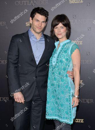 "Josh Helman and Jennifer Allcott attend the STARZ mid-season premiere of ""Outlander"" at the Ziegfeld Theatre, in New York"