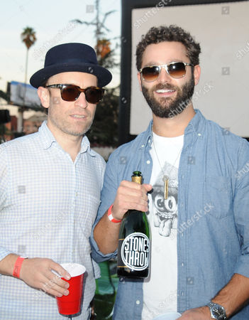 """Chris """"Peanut Butter Wolf"""" Manaks, at left, and Jeff Broadway attend Street Food Cinema featuring Our Vinyl Weighs A Ton: This Is Stone's Throw Records at Exposition Park on in Los Angeles"""