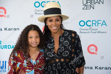 "Summer Chamblain, left, and June Ambrose attend the Ovarian Cancer Research Fund Alliance (OCRFA) 19th annual ""Super Saturday"" garage sale benefit at Nova's Ark Project in Water Mill, in New York"