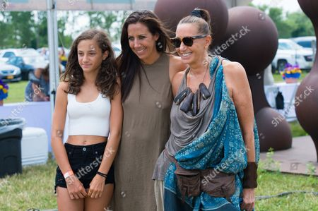 """Stock Photo of Stefania de Felice, left, Gabby Karan de Felice, middle, and Donna Karan attend the Ovarian Cancer Research Fund Alliance's (OCRFA) 19th annual """"Super Saturday"""" garage sale benefit at Nova's Ark Project in Water Mill, in New York"""