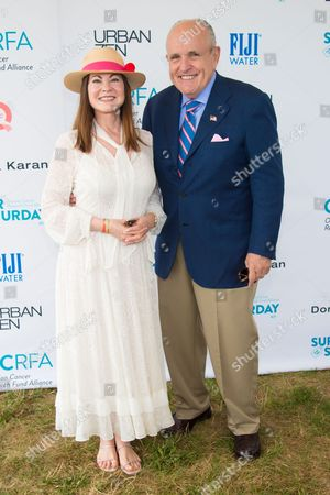 """Judith Giuliani, left, and Rudy Giuliani attend the Ovarian Cancer Research Fund Alliance's (OCRFA) 19th annual """"Super Saturday"""" garage sale benefit at Nova's Ark Project in Water Mill, in New York"""