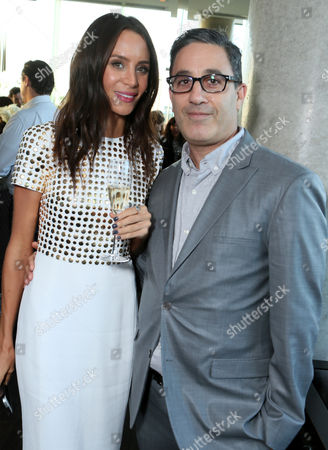 Jade Olivia, left, and Jason Weinberg attend The Hollywood Reporter's Cocktail Reception presented by Bulgari on in Toronto