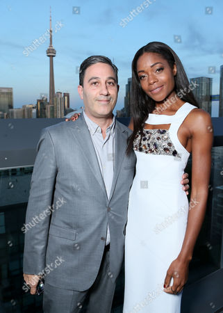 Jason Weinberg, left, and Naomie Harris attend The Hollywood Reporter's Cocktail Reception presented by Bulgari on in Toronto