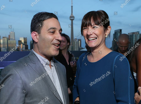 Jason Weinberg, left, and Liz Mahoney attend The Hollywood Reporter's Cocktail Reception presented by Bulgari on in Toronto