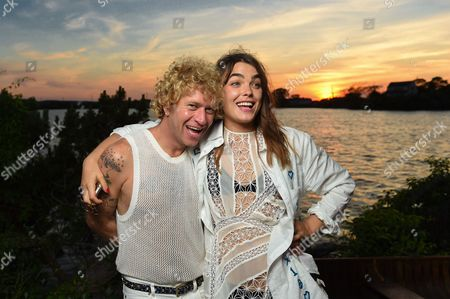 Stock Image of Dan Single, left, and model Bambi Northwood-Blyth attend The Surf Lodge X Zimmermann Collaboration with Solange Knowles and Trombone Shorty, in Montauk, NY