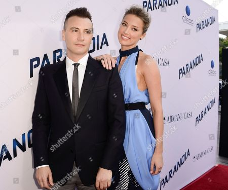 "Actress Amber Heard, right, and director Robert Luketic arrive on the red carpet at the US premiere of the feature film ""Paranoia"" at the DGA Theatre on in Los Angeles"