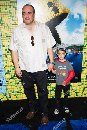 "David Zayas and grandson attend the world premiere of ""Pixels"" at Regal E-Walk, in New York"