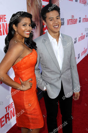 """Tiya Sircar, left, and Tobit Raphael pose together at the world premiere of """"The Internship"""" at the Regency Village Westwood on in Los Angeles"""