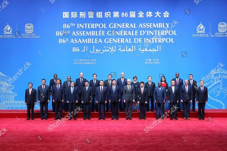 Meng Hongwei, Xi Jinping, Jurgen Stock. Chinese President Xi Jinping, front center, poses with Secretary General of Interpol Jurgen Stock, sixth from right, and President of Interpol Meng Hongwei, sixth from left, for a group photo before the 86th Interpol General Assembly at Beijing National Convention Center in Beijing