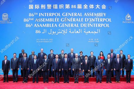 Stock Photo of Xi Jinping, Jurgen Stock, Meng Hongwei. Chinese President Xi Jinping stands with Secretary General Interpol Jurgen Stock, center, right, and Meng Hongwei, center left, president of Interpol, pose for a group photo at the 86th Interpol General Assembly at Beijing National Convention Center, in Beijing, China