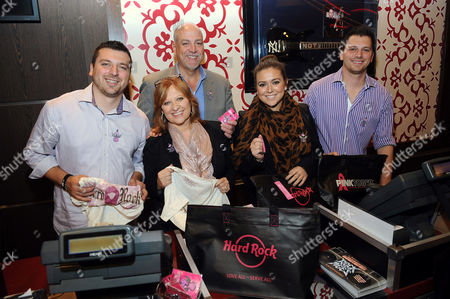 From left, Christopher Manzo, Caroline Manzo, Albert Manzo, Lauren Manzo, and Albie Manzo work in the Hard Rock Cafe Rock Shop in support of the 13th Annual Pinktober Breast Cancer Awareness Campaign, on at Hard Rock Cafe in New York