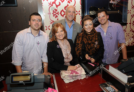 Left to right) Christopher Manzo, Caroline Manzo, Albert Manzo, Lauren Manzo, and Albie Manzo work in the Hard Rock Cafe Rock Shop in support of the 13th Annual Pinktober Breast Cancer Awareness Campaign, on at Hard Rock Cafe, New York