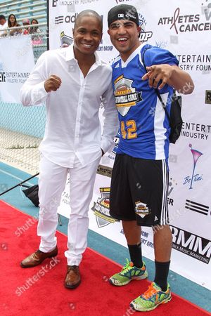 From left, actor Sam Jones III, and professional boxer Victor Ortiz attend the 1st Annual Athletes vs. Cancer Celebrity Flag Football game at the Palisades High School on in Pacific Palisades, Calif