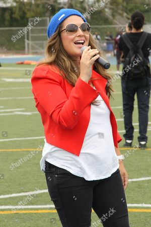 Singer Joy Enriquez attends the 1st Annual Athletes vs. Cancer Celebrity Flag Football game at the Palisades High School on in Pacific Palisades, Calif