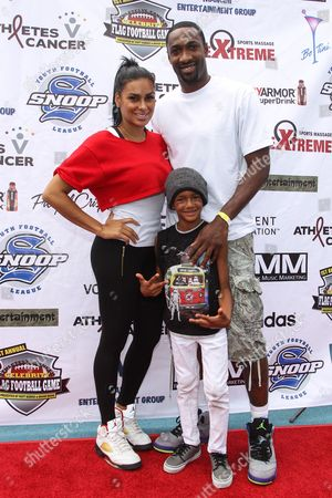 Stock Picture of From left, TV personality Laura Govan and professional basketball player Gilbert Arenas attend the 1st Annual Athletes vs. Cancer Celebrity Flag Football game at the Palisades High School on in Pacific Palisades, Calif