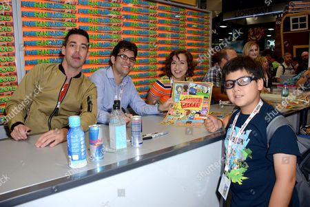 """From left, actors John Roberts, Dan Mintz and Kristen Schaal with a fan attend the FOX """"Bob's Burgers"""" booth signing on Day 3 of Comic-Con International on in San Diego, Calif"""
