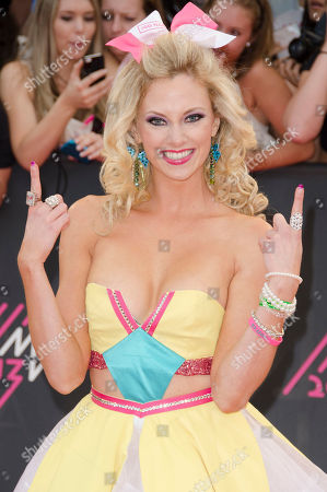 Nicole Arbour arrives on the red carpet at the 2013 MuchMusic Video Awards at the MuchMusic Headquarters, in Toronto, Canada