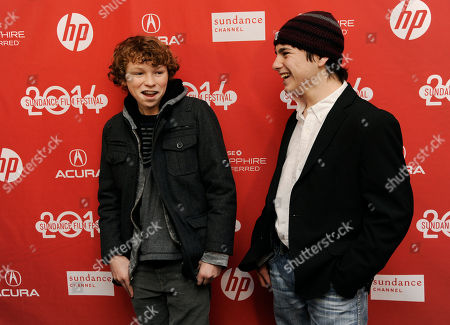 """Stock Picture of Dylan Cole, left, and Camron Owens, cast members in """"Hellion,"""" share a laugh at the premiere of the film at the 2014 Sundance Film Festival, in Park City, Utah"""