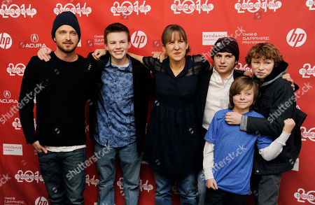 "Writer-director Kat Candler, center, poses with cast members of ""Hellion,"" from left, Aaron Paul, Josh Wiggins, Camron Owens, Deke Garner and Dylan Cole at the premiere of the film at the 2014 Sundance Film Festival, in Park City, Utah"