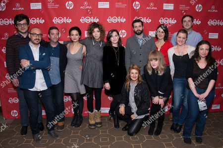 """From left, actor Paul Briganti, Juan Miguel Marin, actor Gabe Liedman, actress Jenny Slate, producer Elisabeth Holm, director Gillian Robespierre, composer Chris Bordeaux, screenwriter Anna Bean, film editor Casey Brooks, front, center to right, Evren Catlin, associate producer Luisa Conlon, production designer Sara K. White, and supervising producer Susan Leber pose at the premiere of the film """"Obvious Child"""" during the 2014 Sundance Film Festival, on in Park City, Utah"""