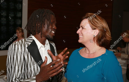 "Emmanuel Jal and Producer Karen Kehela-Sherwood seen at Warner Bros. ""The Good Lie"" Premiere at 2014 TIFF, in Toronto"