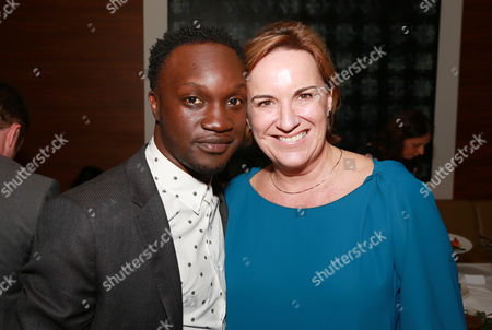 "Arnold Oceng and Producer Karen Kehela-Sherwood seen at Warner Bros. ""The Good Lie"" Premiere at 2014 TIFF, in Toronto"