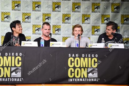"""Director/producer James Wan, from left, actors George Eads and Lucas Till and executive producer Peter Lenkov attend the """"MacGyver"""" panel on day 1 of Comic-Con International, in San Diego"""