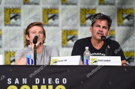 """Lucas Till, left, and executive producer Peter Lenkov attend the """"MacGyver"""" panel on day 1 of Comic-Con International, in San Diego"""