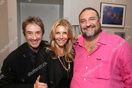 "From left, actor Martin Short, Karyn Fields and Joel Silver pose backstage at the 23rd Annual ""Simply Shakespeare"" event at The Broad Stage on in Santa Monica, Calif"