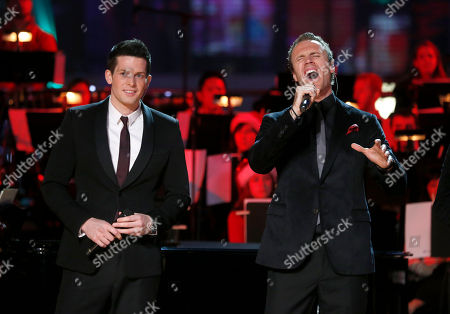 The Canadian Tenors Clifton Murray and Fraser Walters perform at the 5th annual Holiday Tree Lighting at L.A. Live and opening of LA Kings Holiday Ice, in Los Angeles