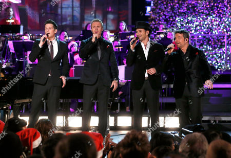 The Canadian Tenors (L-R) Clifton Murray, Fraser Walters, Victor Micallef, and Remigio Pereira perform at the 5th annual Holiday Tree Lighting at L.A. Live and opening of LA Kings Holiday Ice, in Los Angeles