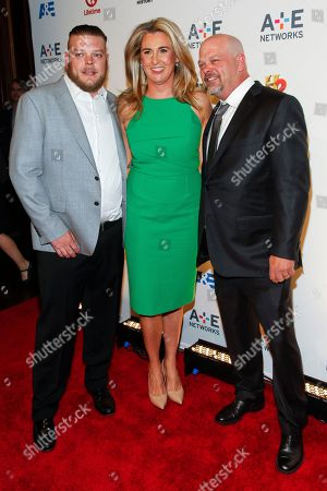 Corey Harrison, from left, President and CEO of A+E Networks, Nancy Dubuc, and Rick Harrison attend the A+E Networks 2015 Upfront at the Park Avenue Armory, in New York