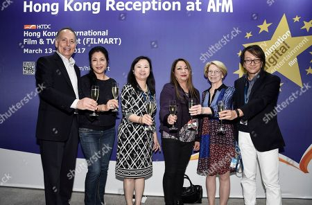 Stock Picture of Jonathan Wolf, Executive Vice President & Managing Director of the American Film Market, Ankie Lau, Lau Film International, Stella Poon, Los Angeles Director of Hong Kong Trade Development Council (HKTDC), Maria Lo Orzel, Founder/Producer of Studio Strada, Jean M. Prewitt, President & CEO of IFTA, and Man Lam, Founder & Contents Development Director, Hong Kong Trade Development Council (HKTCD), cheers at the American Film Market Hong Kong Reception at Ocean & Vine Restaurant at the Loews Santa Monica Beach Hotel, in Santa Monica, Calif