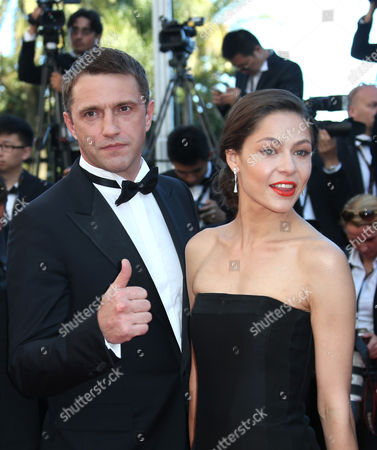 Actor Vladimir Vdovichenkov, left, and actress Elena Lyadova from the film Leviathan pose for photographers as they arrive for the awards ceremony at the 67th international film festival, Cannes, southern France