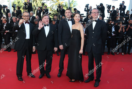 Stock Photo of The cast of Leviathan, from left, director Andrey Zvyagintsev, actor Roman Madianov, actor Vladimir Vdovichenkov, actress Elena Lyadova, and actor Alexei Serebryakov pose photographers as they for for the awards ceremony at the 67th international film festival, Cannes, southern France