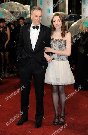 British actor Daniel Day Lewis, left, and his niece Charissa Shearer arrive for the BAFTA Film Awards at the Royal Opera House, in London