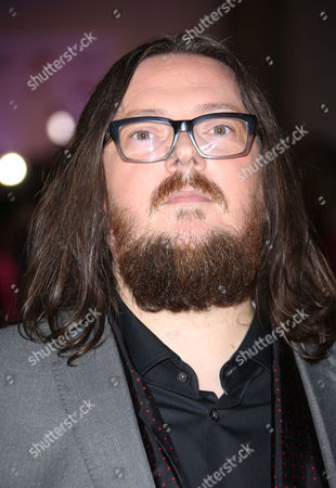Director Iain Forsyth arrives for the UK Gala Screening of '20,000 Days On Earth', a film by Nick Cave, at the Barbican Centre in central London