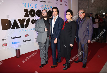 From left, Director Iain Forsyth, Nick Cave, Director Jane Pollard and actor Ray Winstone arrive for the UK Gala Screening of '20,000 Days On Earth', a film by Nick Cave, at the Barbican Centre in central London