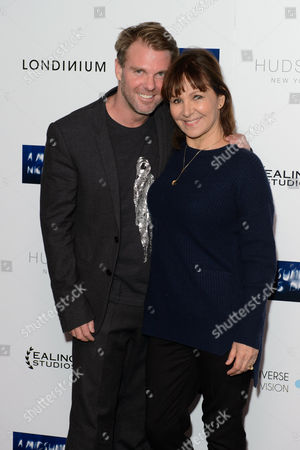 Stock Image of Ben Latham-Jones and Arlene Phillips pose for photographers at the UK Premiere of A Midsummer Nights Dream at a central London cinema