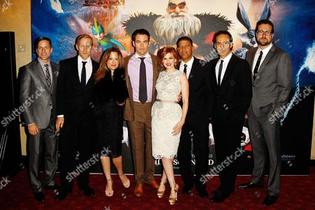Stock Photo of From left, Bill Damaschke, Hamish Grieve, producer Christina Steinberg, actor Chris Pine, actress Isla Fisher, director Peter Ramsey, composer Alexandre Desplat and production designer Patrick Hanenberger are seen at the Rise of the Guardians premiere in Leicester square, in London