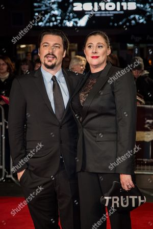Amber Freeman and James Vanderbilt pose for photographers upon arrival at the premiere of the film 'Truth', as part of the London film festival in London