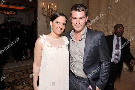 Jeff Branson, right, and guest attend the Daytime Emmy Nominee Cocktail Reception in Beverly Hills, Calif., on