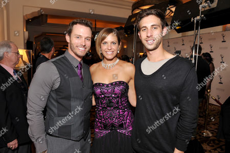 Arianne Zucker, center, Blake Berris, right, and guest attend the Daytime Emmy Nominee Cocktail Reception in Beverly Hills, Calif., on