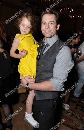 Michael Muhney and his daughter attend the Daytime Emmy Nominee Cocktail Reception in Beverly Hills, Calif., on