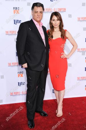 """Joseph Siravo, left, and Jessica Blair Herman attend the LA Premiere of """"'American Crime Story: The People v. O.J. Simpson"""" held at Westwood Village Theatre, in Los Angeles"""