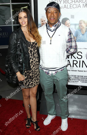 "Russell Simmons, right, and Hana Nitsche arrive at the premiere of ""Thanks for Sharing"" at the ArcLight Hollywood on in Los Angeles"