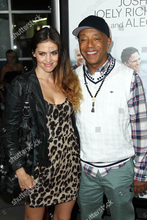 """Russell Simmons, right, and Hana Nitsche arrive at the premiere of """"Thanks for Sharing"""" at the ArcLight Hollywood on in Los Angeles"""