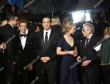 From left, Evan Bird, John Cusack, Mia Wasikowska and David Cronenberg on the red carpet for the screening of Maps to the Stars at the 67th international film festival, Cannes, southern France